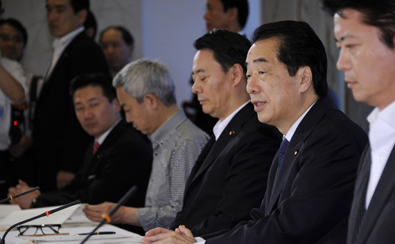 Japanese Prime Minister Naoto Kan (2nd R) attends a cabinet meeting on environment and energy in Tokyo June 22, 2011.