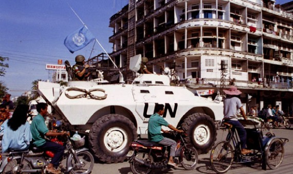 UN peacekeepers from Indonesia patrol the streets of Phnom Penh in an armoured personel carrier on August 27, amid the morning rush hour traffic