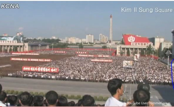 North Koreans shout slogan during a massive rally at Kim Il Sung Square in Pyongyang, North Korea, to denounce the conservative government of South Korean President Lee Myung-bak on July 4, 2011.