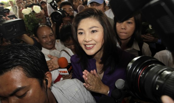 Yingluck Shinawatra, sister of ousted premier Thaksin Shinawatra, smiles as she arrives to her party's headquarters after voting in general elections ended in Bangkok July 3, 2011.