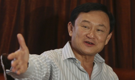 Former Thai Prime Minister Thaksin Shinawatra gestures during a meeting near his home in Dubai, after voting in general elections ended in Bangkok July 3, 2011.