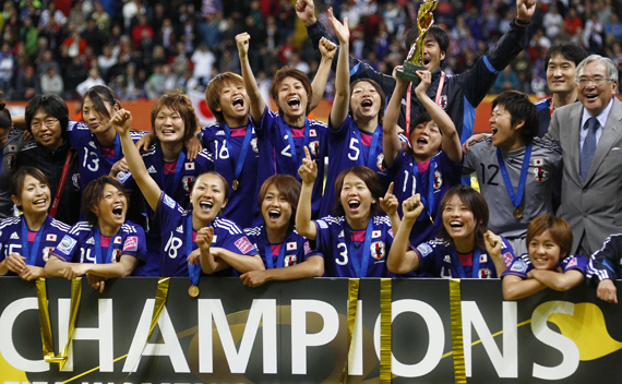 Japan's players celebrate with the trophy after the victory against the U.S. in their Women's World Cup final soccer match in Frankfurt July 17, 2011.