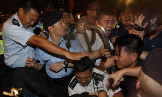 Pro-democracy protesters scuffle with police during a protest march to demand universal suffrage and against rising property prices in Hong Kong July 1, 2011.