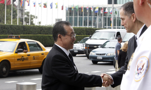 North Korean Vice Foreign Minister Kim Kye-gwan (L) shakes hands with Clifford Hart, Special Envoy to the Six Party Talks on North Korean De-Nuclearization, as he arrives at the U.S. Mission to the United Nations in New York, July 29, 2011