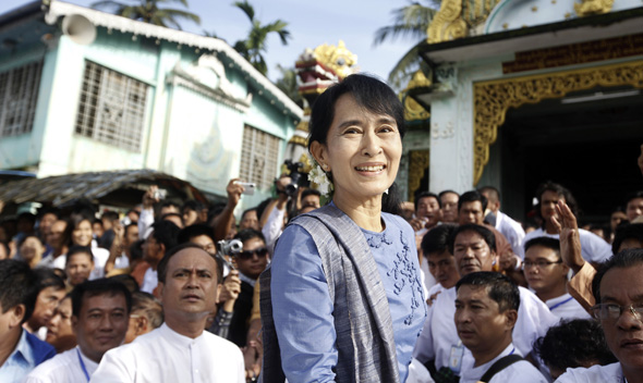 Aung San Suu Kyi, leader of Myanmar's democratic opposition, smiles to supporters August 14, 2011.