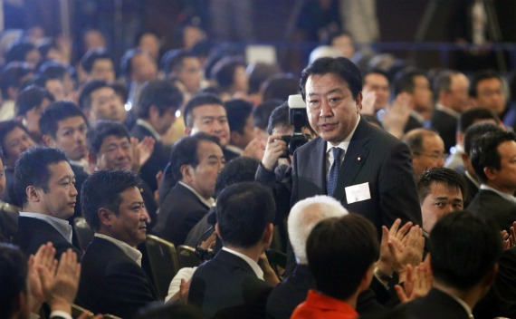 Japan's Finance Minister Yoshihiko Noda stands up as he is chosen as the party's new leader while the party lawmakers clap their hands during Japan's ruling Democratic Party of Japan leadership vote in Tokyo on August 29, 2011.