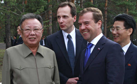 Russia's President Dmitry Medvedev (R front) and North Korean leader Kim Jong-il (L) smile during their meeting at the