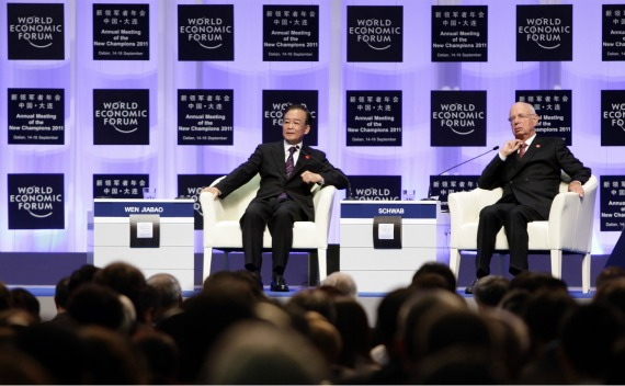 China's Premier Wen Jiabao and Klaus Schwab, founder and executive chairman of the World Economic Forum (WEF), attend the opening ceremony of the WEF Annual Meeting of the New Champions in northeastern China's port city of Dalian on September 14, 2011.