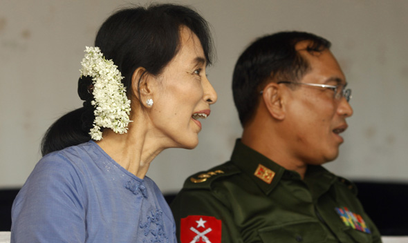 Myanmar Pro-Democracy leader Aung San Suu Kyi and Yangon Division government's security and border affairs minister colonel Tin Win watch the Asean U-19 soccer match in Yangon.