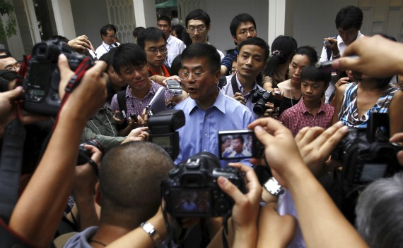 Ambassador Gary Locke is surrounded by local Chinese media outside his residence in Beijing on August 14, 2011.