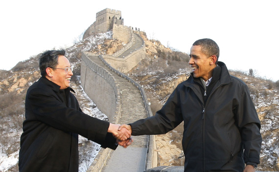 U.S. President Barack Obama (R) shakes hands with Chinese Ambassador to the United States Zhou Wenzhong during a tour of the Great Wall of China in Badaling November 18, 2009.