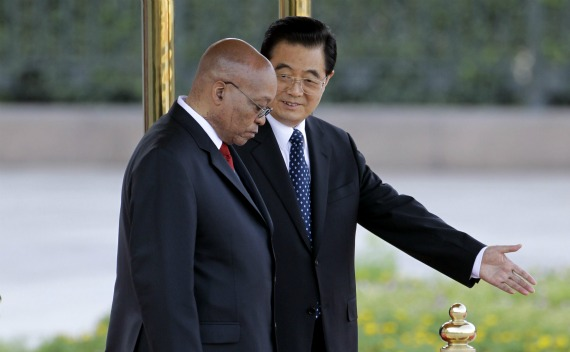 China's President Hu Jintao shows the way to South Africa's President Jacob Zuma during a welcome ceremony outside the Great Hall of the People in Beijing on August 24, 2010.