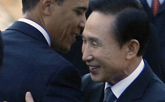 U.S. President Barack Obama gets a hug from South Korean President Lee Myung-bak at the Blue House in Seoul, November 19, 2009.