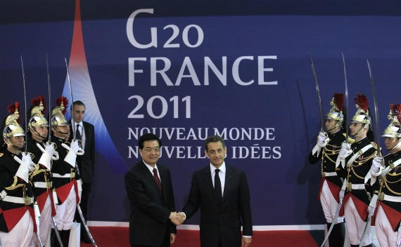 France's President Nicolas Sarkozy welcomes China's President Hu Jintao at the G20 venue where world leaders gather in Cannes on November 2, 2011.