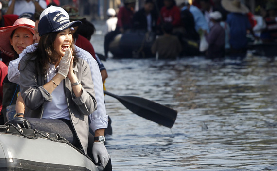 Thailand's Prime Minister Yingluck Shinawatra gestures to residents during her visit to a flooded area at Don Muang district in Bangkok.