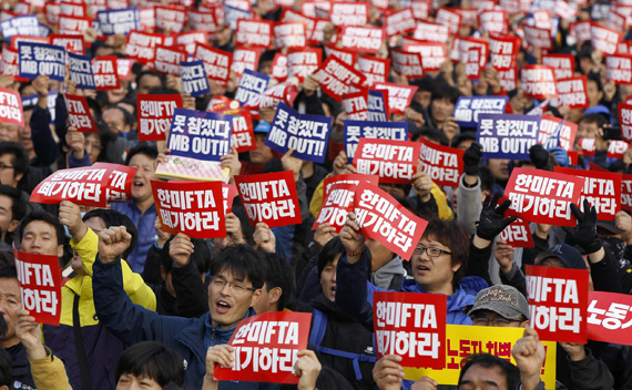 Union workers from Korean Confederation of Trade Unions shout slogans during a demonstration in Seoul