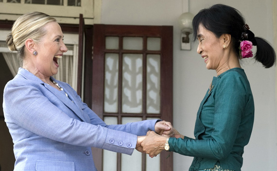 Pro-democracy leader Aung San Suu Kyi (R) and U.S. Secretary of State Hillary Clinton hold hands as they speak after meeting at Suu Kyi's residence in Yangon December 2, 2011.
