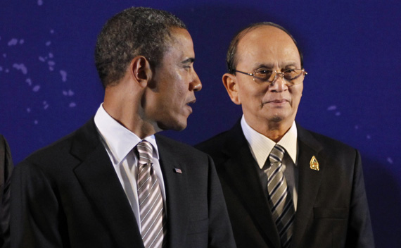 U.S. President Obama looks back at Myanmar's President Thein Sein as they participate in a group photo of leaders at the East Asia Summit in Nusa Dua.