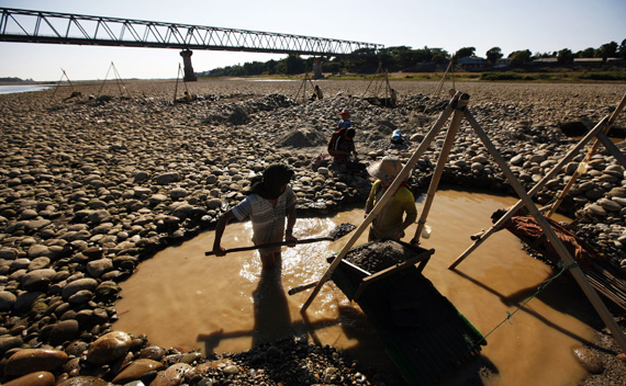 Villagers pan for gold from the Irrawaddy river near the town of Myitkyina in northern Myanmar. Myitkyina has been an important trading town between China and Myanmar since ancient times.