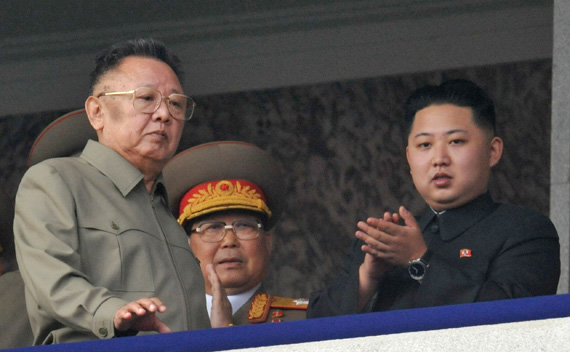 North Korean leader Kim Jong-il (L) walks in front of his youngest son Kim Jong-un (R) as they watch a parade to commemorate the 65th anniversary of the founding of the Workers' Party of Korea in Pyongyang October 10, 2010