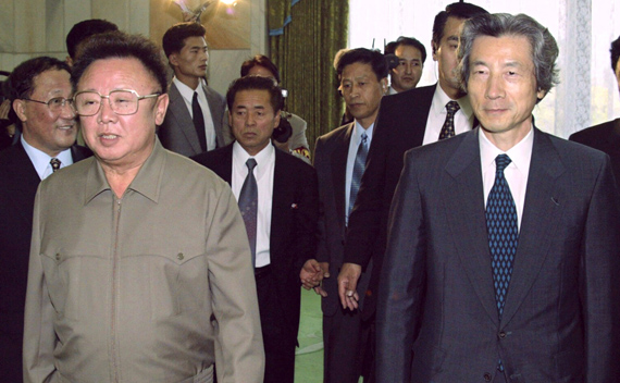 Japanese Prime Minister Junichiro Koizumi (R) is accompanied by North Korean leader Kim Jong-il to a conference room for their landmark summit in Pyongyang in this September 17, 2002 file photo