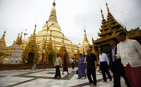 North Korea's Foreign Minister Pak Ui-chun (4th R) visits the Shwedagon Pagoda in Yangon, Myanmar July 29, 2010.