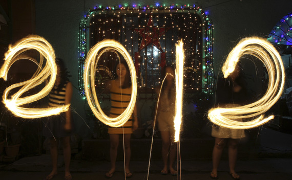 Women use sparklers to draw