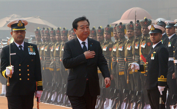Japan's Prime Minister Yoshihiko Noda inspects a guard of honour during his ceremonial reception at the presidential palace in New Delhi