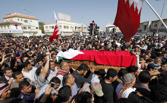 People carry the body of a protester killed on Monday, February 14, 2011 in Bahrain.