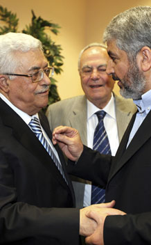Hamas leader Khaled Meshaal (R) talks with President Mahmoud Abbas (L) during their meeting in Cairo May 4, 2011.