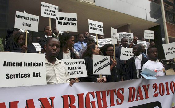 Lawyers hold a protest march to commemorate Human Rights Day in Harare, Zimbabwe, December 9, 2010.