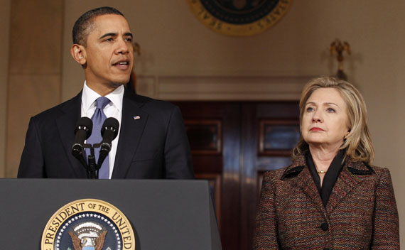 President Barack Obama speaks about Libya as Secretary of State Hillary Clinton listens in the White House on February 23, 2011.