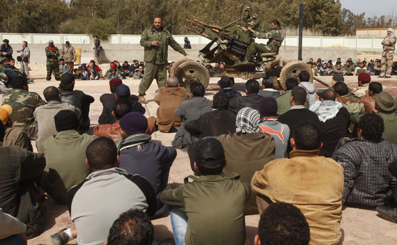 Rebel soldiers teach civilian volunteers at a school in Benghazi on March 2, 2011.