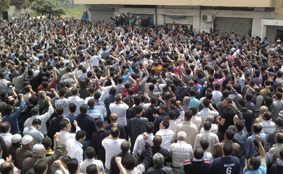 Protesters shout slogans during a demonstration after Friday prayers in the Syrian port city of Banias April 29, 2011.