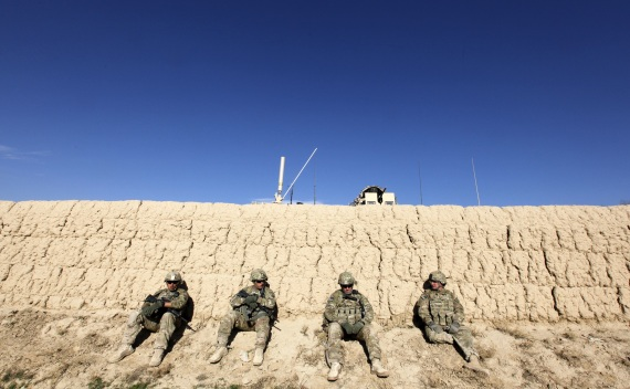 U.S. Army soldiers sit behind a wall after an IED blast in Logar province on November 23, 2011 (Umit Bektas/Courtesy Reuters).