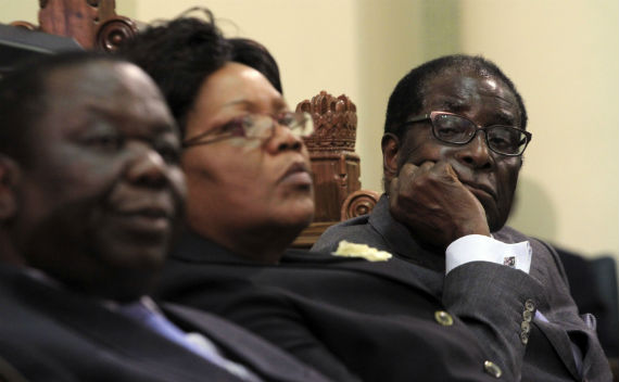 Zimbabwean President Robert Mugabe (R) listens as Finance Minister Tendai Biti delivers his budget speech in parliament in Harare November 24, 2011 (Philimon Bulawayo/Courtesy Reuters)