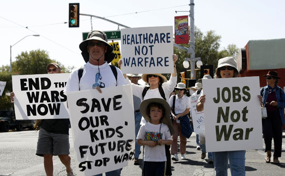 People protest in the streets regarding the United States' actions in Libya, in Tucson, Arizona on March 19, 2011.