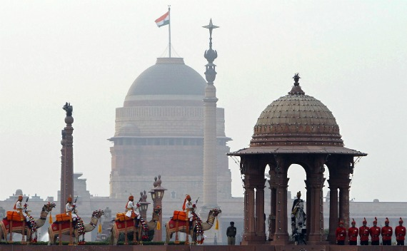 India's BSF soldiers ride their camels in front of the Presidential Palace during the full-dress rehearsal for