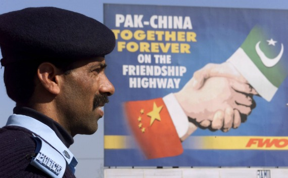 A Pakistani policeman keeps watch near a Pakistan-China friendship billboard in Islamabad February 3, 2002. (Claro Cortes IV / Courtesy Reuters)