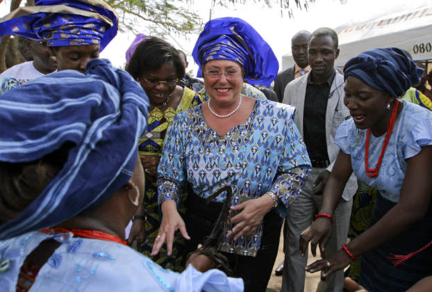 The first Executive Director of UN Women, Michelle Bachelet, dances with women in Nigeria's capital Abuja January 11, 2013. (Eduardo Munoz/Reuters)