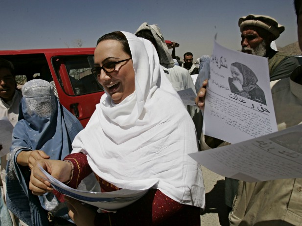 Shukria Barakzai, a member of parliament, hands out leaflets during her August 2005 election campaign in Kabul, Afghanistan. Barakzai later survived a suicide bombing attack in December 2014 (Courtesy Zohra Bensemra/Reuters).