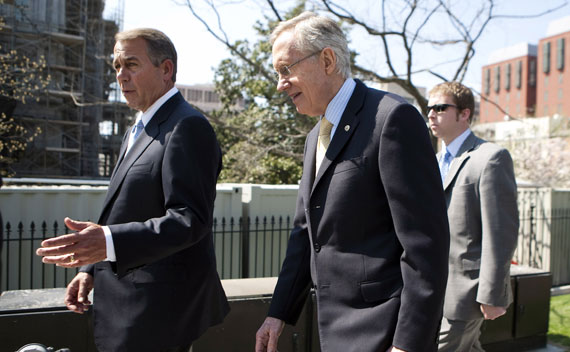 John Boehner (R-OH) and Harry Reid (D-NV) walk together after speaking with President Obama about the continuing budget negotiations on April 7, 2011.