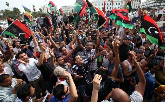 Residents celebrate at Martyrs square in Tripoli October 20, 2011 after hearing the news that former leader Muammar Gaddafi was killed in Sirte (Ismail Zetouni/Courtesy Reuters).