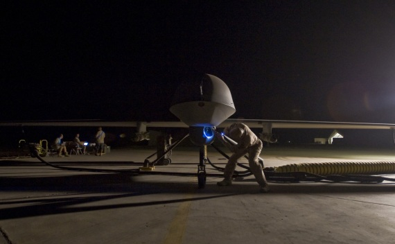 Lt. Col. Geoffrey Barnes, Detachment 1 46th Expeditionary Reconnaissance Attack Squadron commander, performs a pre-flight inspection of an MQ-1B Predator unmanned drone aircraft on September 3, 2008 (Christopher Griffin/Courtesy Reuters).