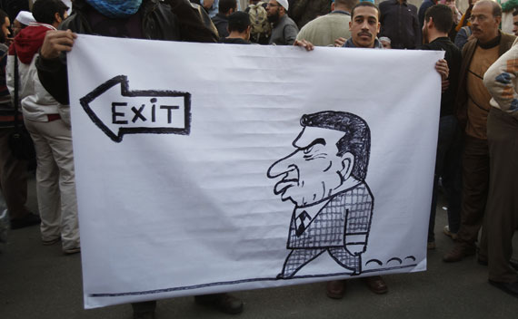 Protesters hold a banner during a demonstration in Cairo
