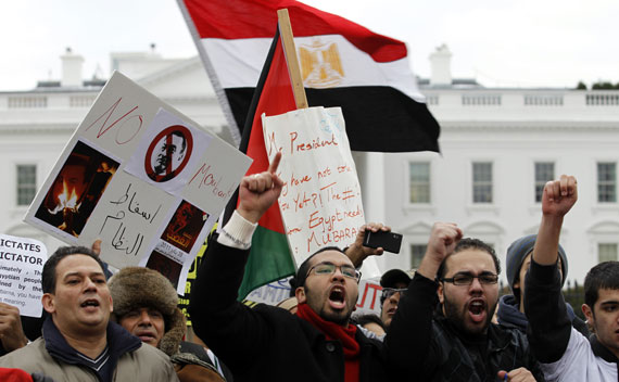 Demonstrators shout slogans during protest outside the White House