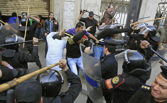 Riot police clash with protesters in Cairo January 26, 2011.