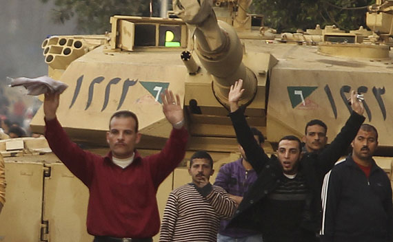 Pro-Mubarak supporters surrender to opposition demonstrators during rioting near Tahrir Square in Cairo.