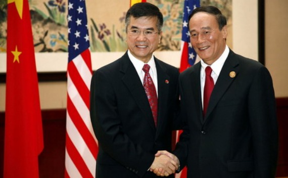 Gary Locke  (L) and Wang Qishan (R)