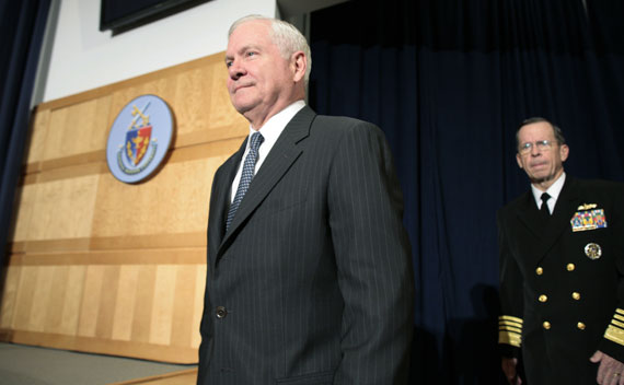 U.S. Secretary of Defense Gates and Admiral Mullen enter the auditorium before Oabma's speech about the conflict in Libya at the National Defense University on March 28, 2011.